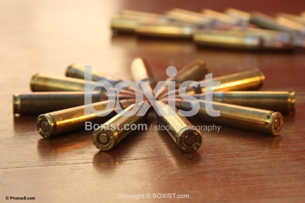 Bullets Star on Wooden Surface