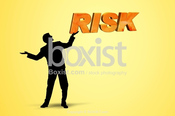 Businessman Carrying Risk Sign