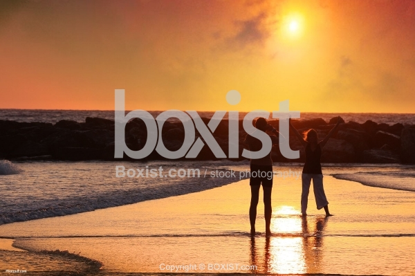 Couple taking picture at Beach