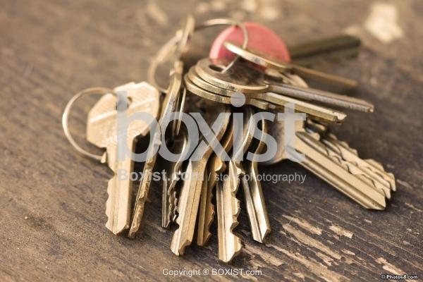 Rusty Keys on Wooden Surface