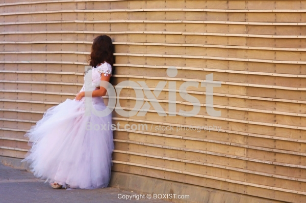 Bride Standing Against Wooden Wall