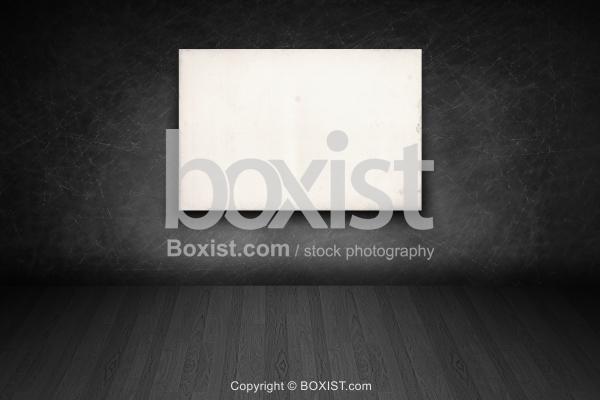 Blank Advertisement in Dark Empty Room Wall