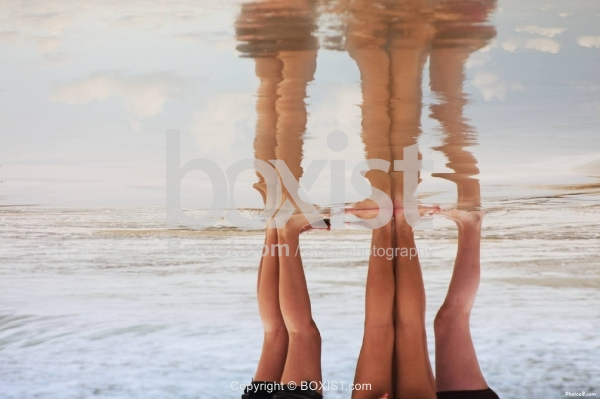 Legs Reflection on Water