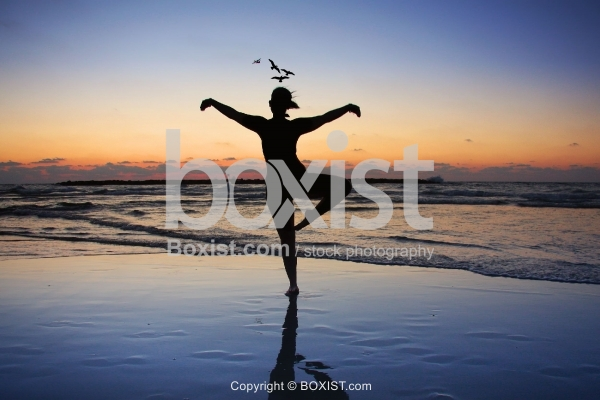 Beach Sunset Flying Girl Silhouette