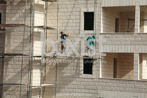 Construction Workers Working without Safety