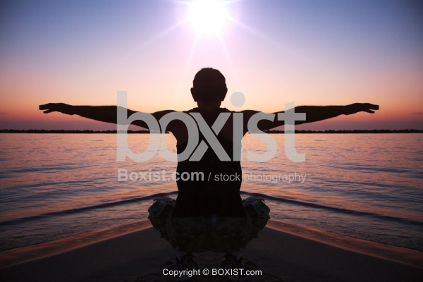 Man Open Armed at Sunset