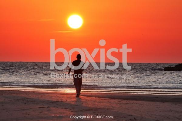 Man Walking Under Sunset Alone