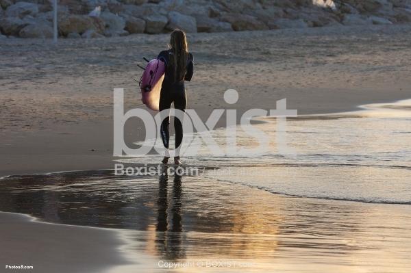 Surfer Girl Walking on Beach