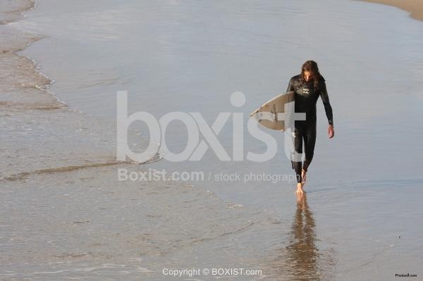 Surfer Man Walking on the Beach
