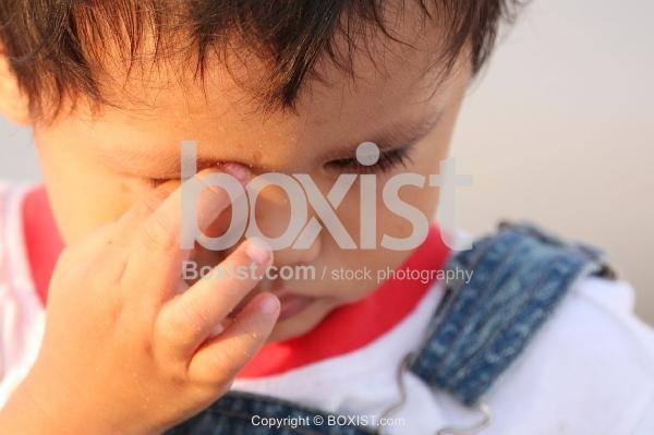 Sad Boy Rubbing Eye