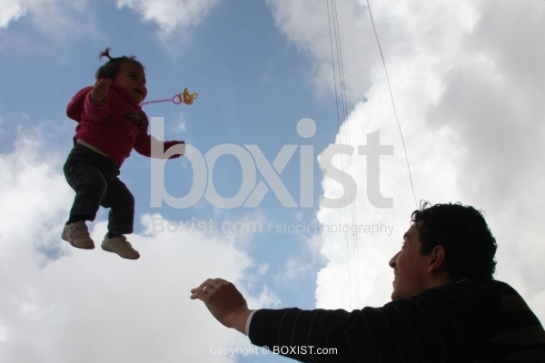 Father Throw In Air His Little Daughter