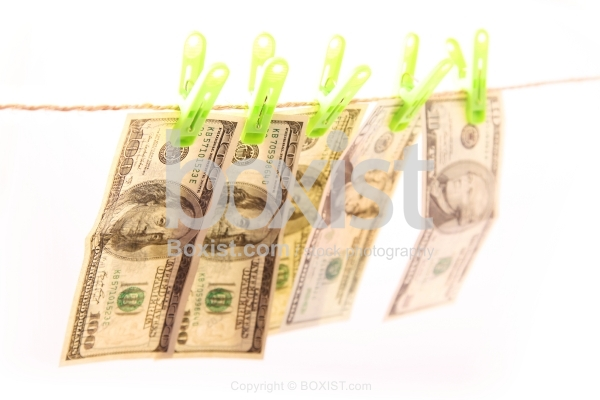 Dollars Bills Hanging on Laundry Line Attached with Clips