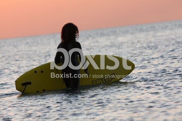 Girl Holding Surfing Board
