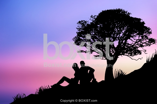 Silhouette Couple Sitting Under Tree at Sunset