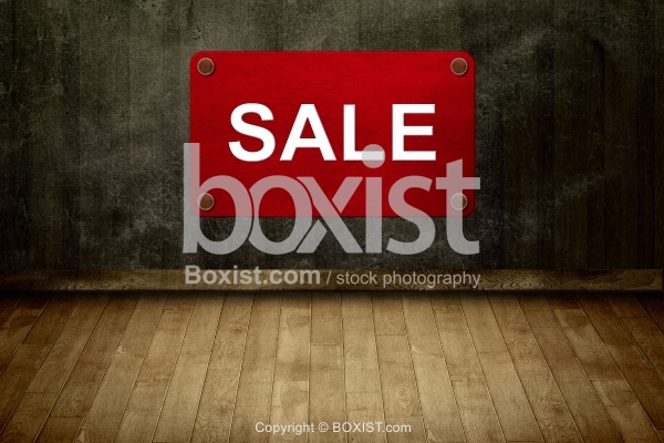 Wooden Floor With Red Sign Of Sale