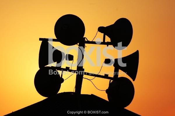 Sky Speakers Against Orange Sky Background