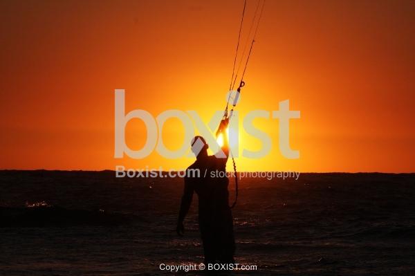 Kite Surfer Standing at Sunset