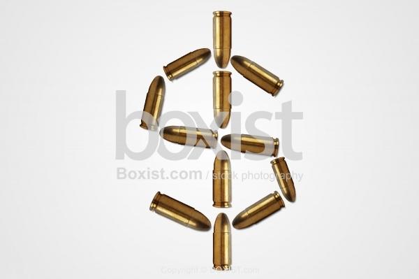 Dollar Symbol Made of Bullets