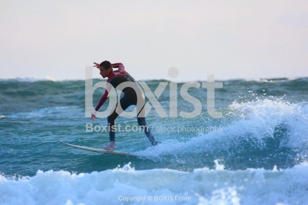 Man Surfing Over Sea Waves