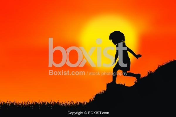 Young Child Silhouette Walking on Mountai