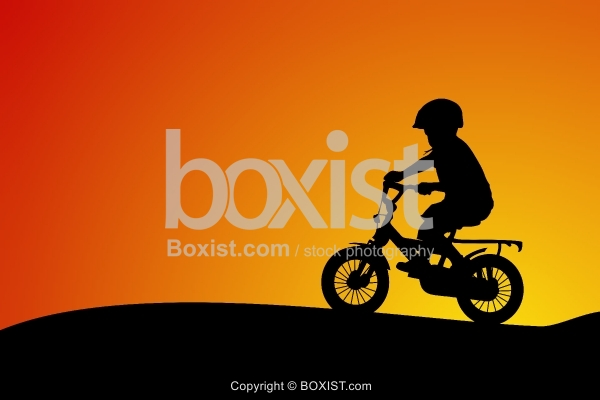 Boy on Bicycle Silhouette at Sunset