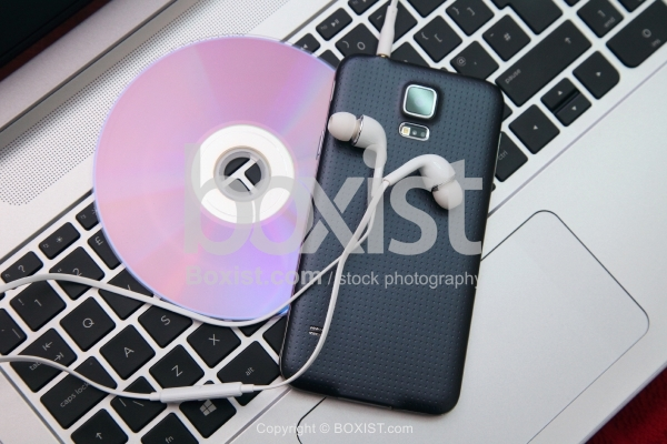 Laptop With Smartphone And Headphones