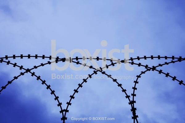 Razor Blade Wire Against Blue Sky