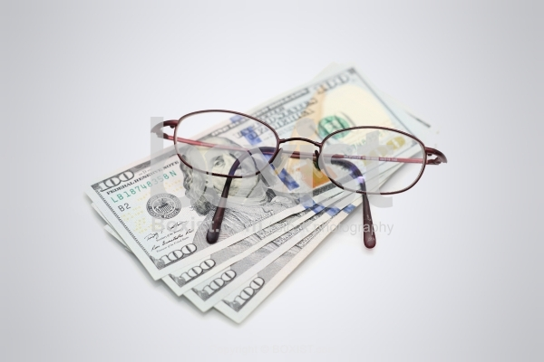 Hundred Dollars Banknotes And Glasses