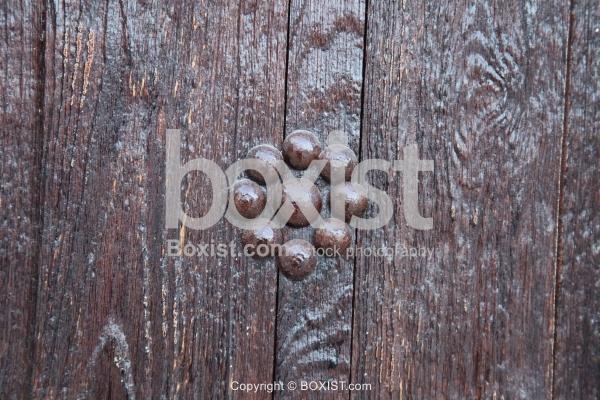 Wooden Door with Decorative Screws