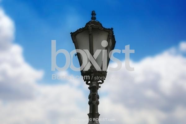 Street Pole Against Cloudy Blue Sky