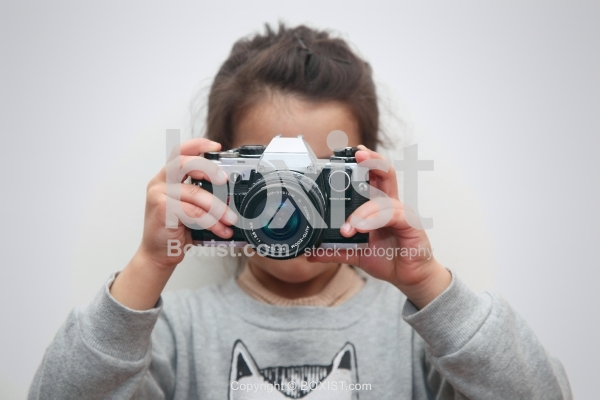 Young Girl Taking Picture with Camera