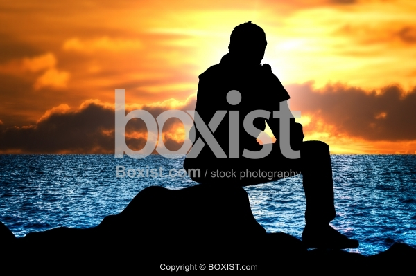 Man Alone Sitting and Watching at Sunset