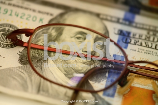 Reading Glasses Over One Hundred Dollar Bill