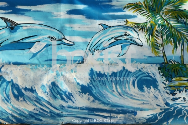 Painting of Swimming Dolphins In Water
