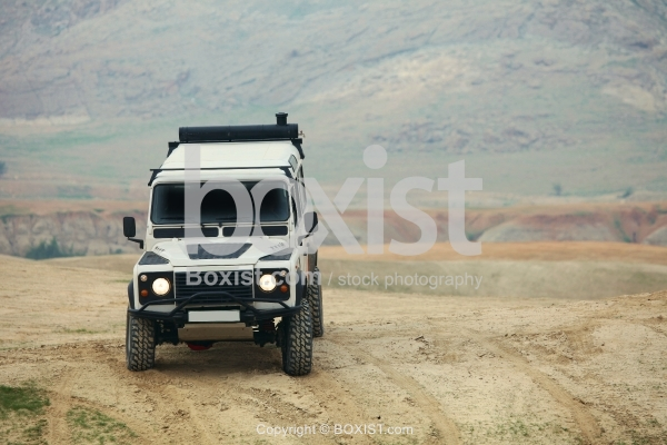 Four Wheel Vehicle on Top of the Hill