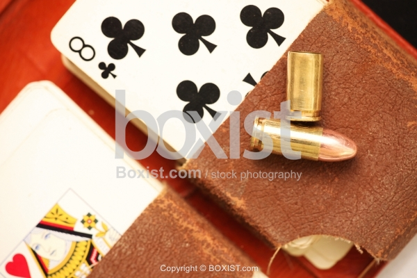 Playing Cards And Gun Bullets
