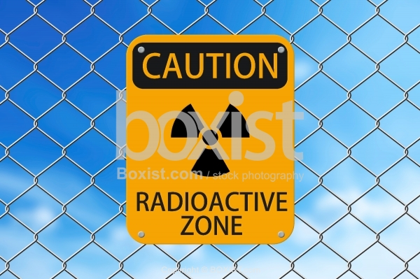 Caution Radioactive Zone Sign On Fence
