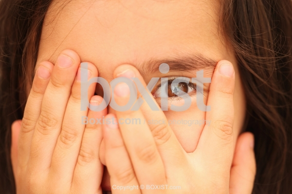 Little Girl Closing One Eye With Hand