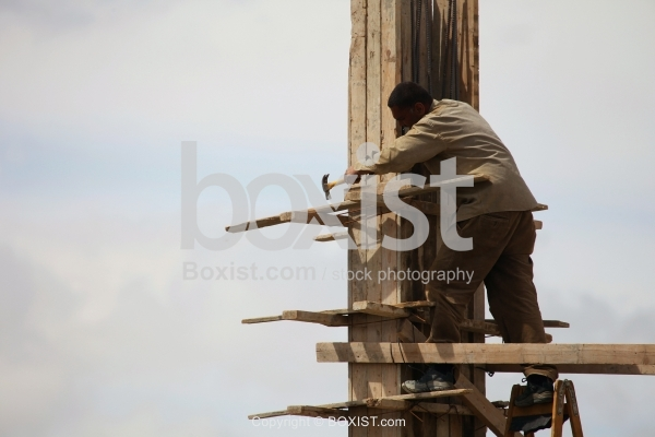 Construction Worker On Column