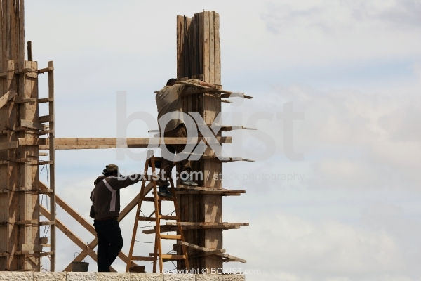 Construction Workers With Wood Building