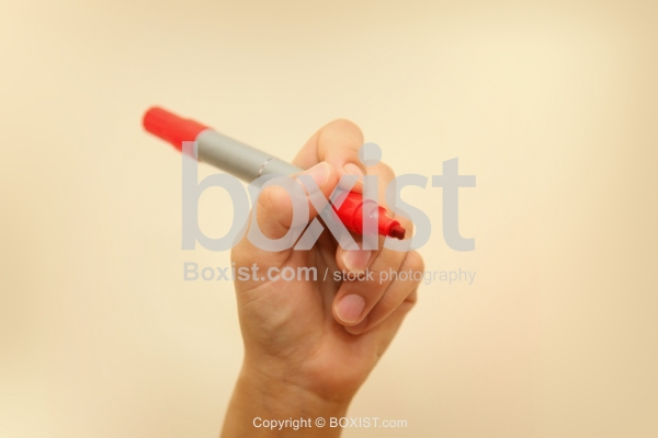 Hand Holding Red Pen