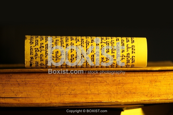 Jewish Scroll In Hebrew On Top Of Old Book