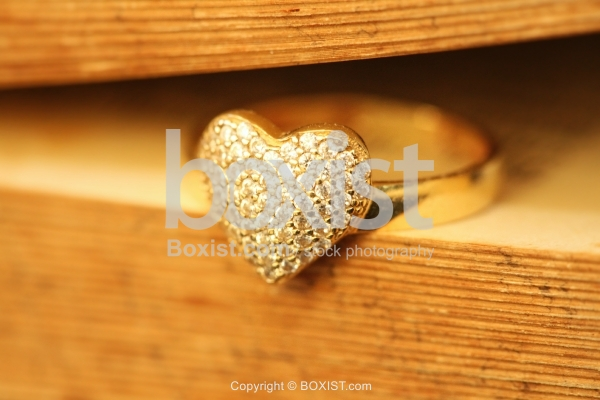 Ring With Heart Shape In Book