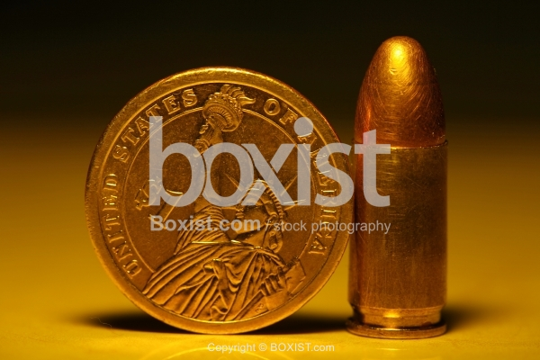 Dollar Coin And 9mm Bullet