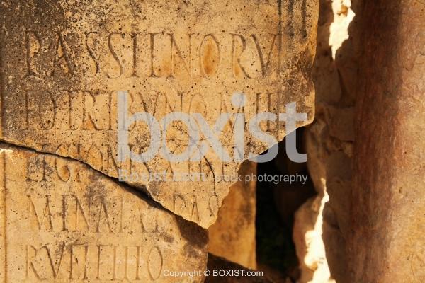 Broken Stone With Roman Inscription