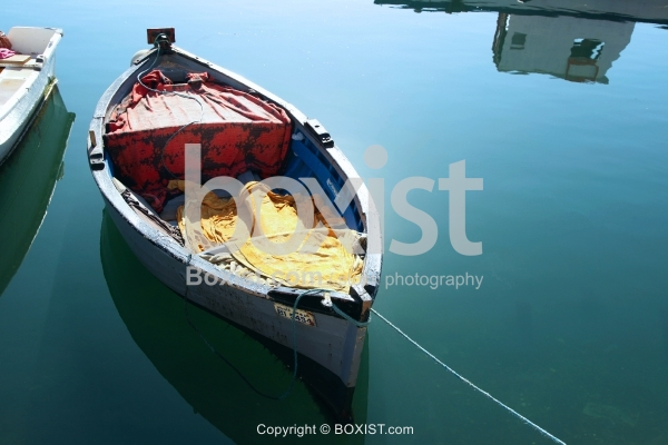 Small Fishing Boat In Water