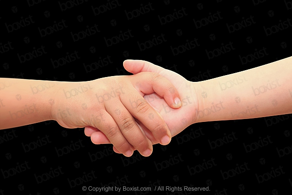 Children Holding Hands on Black Background