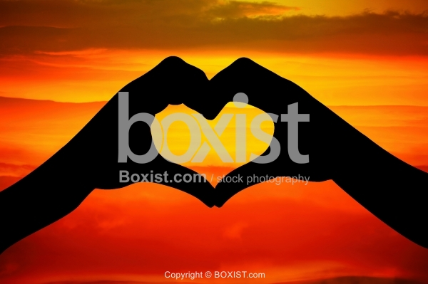 Hands In Heart Shape With Beautiful Sunset In Background