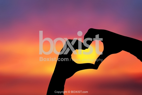 Love Heart Hands Against Colorful Sunset Background