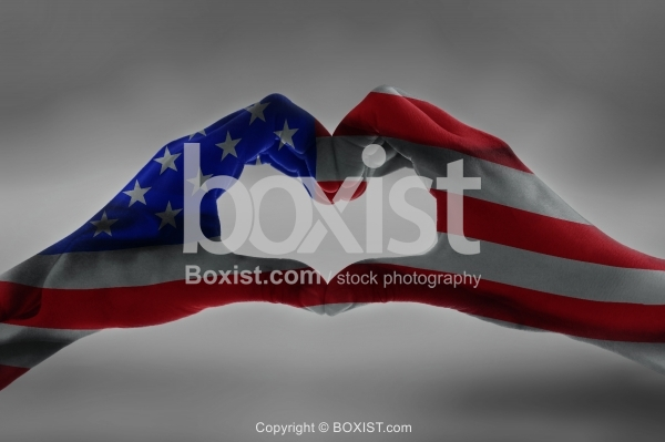Hands With American Flag In Heart Shape Concept